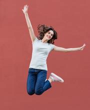 Joyful Happy Young Woman Jumpi...