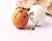 Two Funny White Eggs With Face...