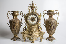 Bronze Amphorae And Clock On A...