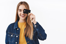Carefree And Happy Smiling Girl Showing Credit Card Near Eye, Finally Receive Payment, Gonna Waste Money, Place Cash On Deposit, Using Cashback, Making Investment, Stand White Background