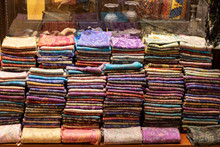 Folded Scarves In Front Of The...