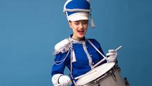 Drummer In A Blue Uniform Drums On A Drum, Show Program And Celebration.