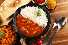 Chicken Tikka Masala Spicy Curry Meat Food In Pot With Rice And Naan Bread. Indian Food On Table