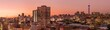 canvas print picture - A beautiful and dramatic panoramic photograph of the Johannesburg city skyline, taken on a golden evening after sunset.