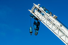 Huge Hydraulic Truck Crane And Giant Hook With Clear Blue Sky Background