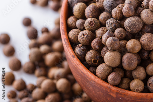 fresh spicy peppers allspice on white acrylic background Wallpaper Mural