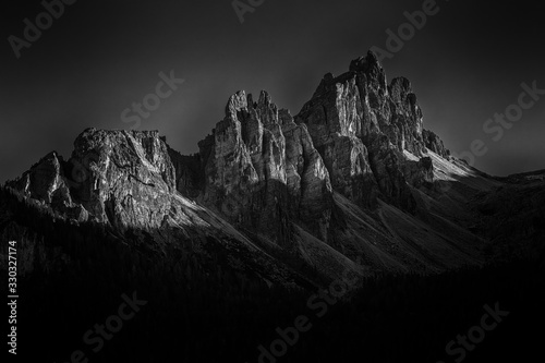Grayscale shot of Dolomites mountain in Italy