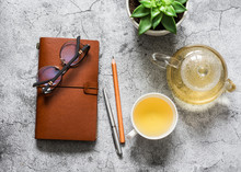 Tea Break. Green Tea, Work Desk With Leather Business Organizer, Succulent Flower On Grey Background, Top View