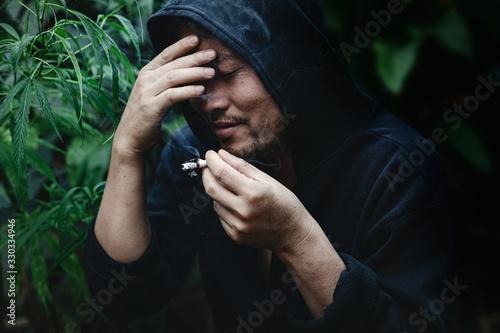 A Man Smokes Cannabis Weed. Canvas Print
