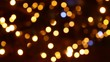 Multi-colored festive lights in defocus