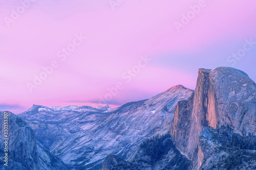 Landscape of Half Dome and the Sierra Nevada Mountains from Glacier Point at twilight, Yosemite National Park, California, USA