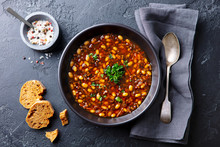 Bean Soup In A Black Bowl. Dar...