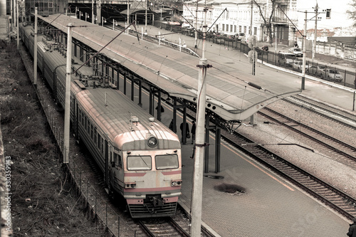 Electric train at the railway station Canvas Print