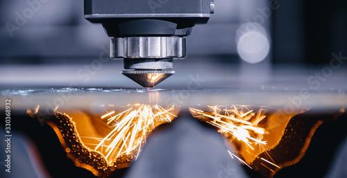 Fotografia CNC gas cutting metal sheet, sparks fly