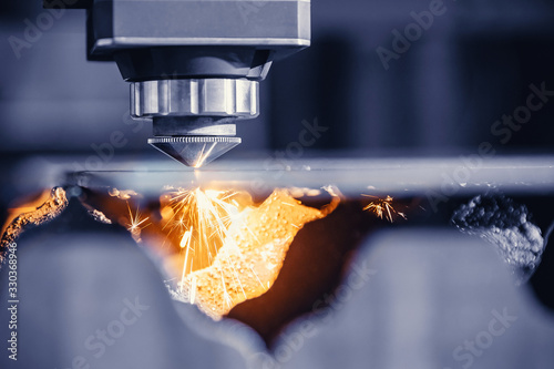 CNC gas cutting metal sheet, sparks fly Canvas Print