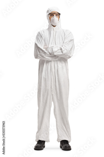 Man wearing a decontamination suit and mask and posing with crossed arms Wall mural