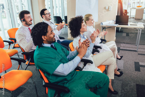 Fototapeta Group of doctors on seminar in lecture hall at hospital. Hospital, profession, people and medicine concept obraz