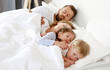 canvas print picture - healthy sleep. happy family parents and children sleeping in white bed  .