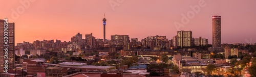 Obraz A beautiful and dramatic panoramic photograph of the Johannesburg city skyline, taken on a golden evening after sunset. - fototapety do salonu