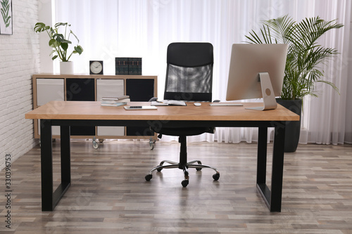 Fototapeta Director's office with large wooden table. Interior design obraz