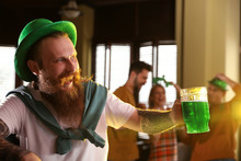 Man With Glass Of Green Beer I...