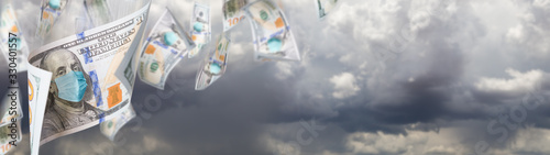 Photo 100 Dollar Bills with Medical Face Mask Falling From Stormy Cloudy Sky Banner