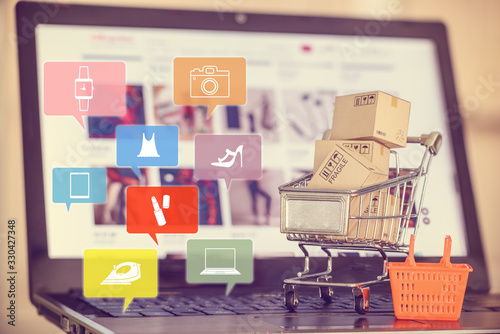 Online shopping, e-commerce experience concept : Box / carton with shopping cart Wallpaper Mural
