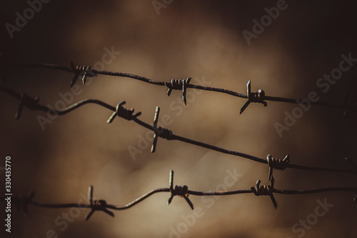 Old rusty barbed wire fence at a military facility Canvas Print