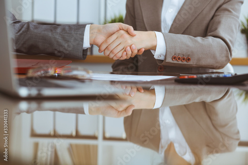 Group of business people or lawyers at meeting shaking hands, close-up Wallpaper Mural
