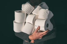 Toilet Paper Shortage Coronavirus Panic Buying Man Hoarding Carrying Many Rolls At Home In Fear Of Corona Virus Outbreak Closing Shopping Stores.
