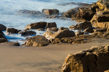 Part Of A Rocky Beach With The Sea On The Shore