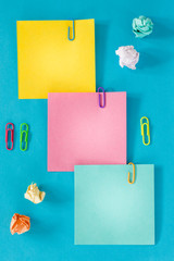 Colorful cards with space for an inscription, office or business concept, staples, crumpled balls of paper.
