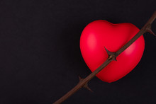 Red Heart On A Black Backgroun...