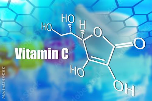 Photo Molecular formula and the inscription vitamin C on a blue background