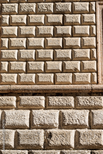 Ashlar (Bugnato in Italian), closeup of a wall made of big blocks of stones in T Wallpaper Mural