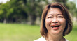 Portrait of happy senior adult elderly asian women smiling and looking at camera in the park.Retirement concept
