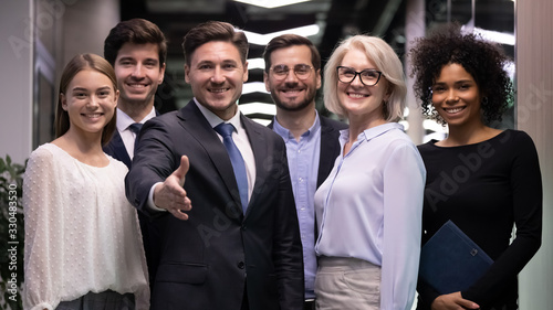 Group portrait of diverse businesspeople stand together meeting newbie to intern Wallpaper Mural