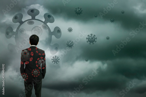 Fotografie, Tablou Businessman standing wtih storm cloudy background, Business crisis challenge con