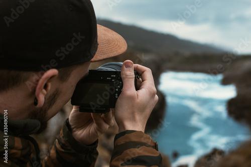Fototapeta Photographer filmmaker cameraman at the beach shooting open plan