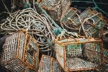 Closeup Of Crab Traps And Ropes On The Ground Under The Lights