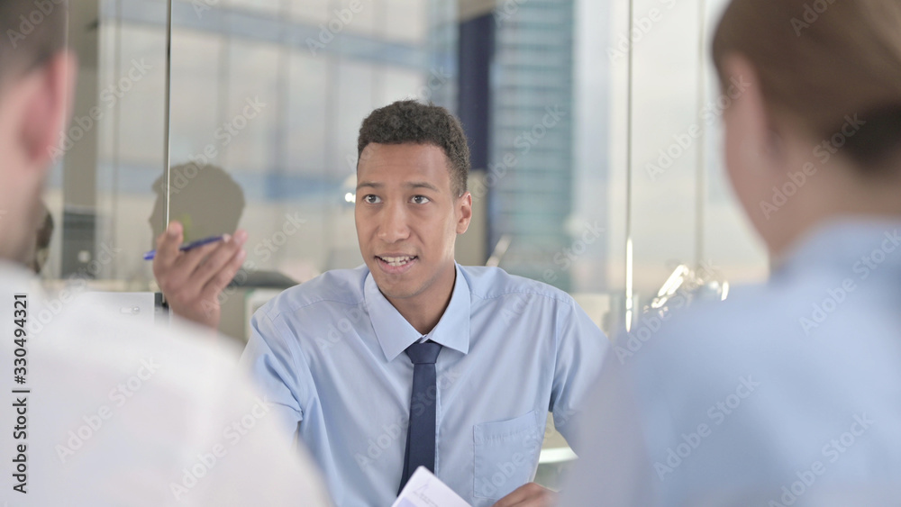 Fototapeta The Business Team getting Argument from African Businessman on Office Table