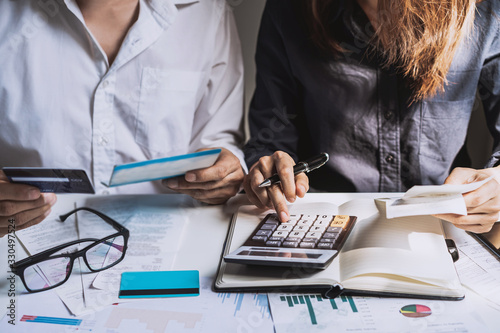 Cuadros en Lienzo Stressed young couple checking bills, taxes, bank account balance and calculatin