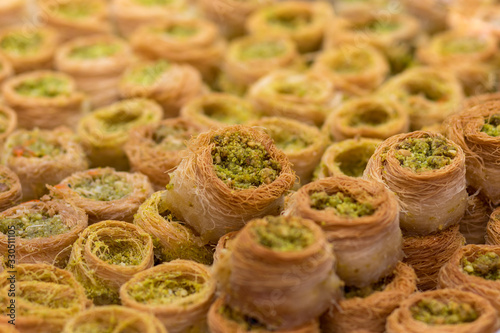 Baklawa (baklawa) traditional and authentic Middle Eastern Arabian pastry, fried dough wires, honey, in the shape of an open square Canvas Print