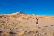 Girl Hiking To Sand Dunes Of K...