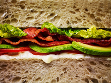 A Bacon, Lettuce And Tomato Sandwich On White Bread