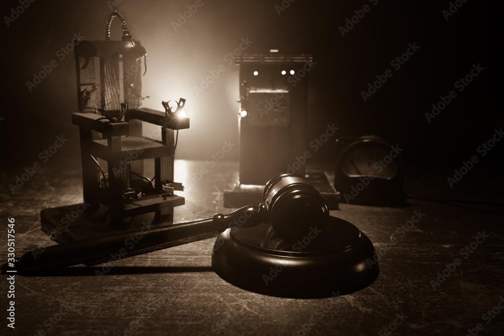 Fototapeta Death penalty electric chair miniature on dark. Creative artwork decoration.