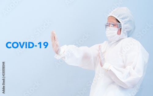 A doctor wearing personal protective equipment or ppe including mask, goggle, an Fototapeta