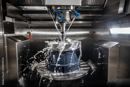 Fototapeta Metalworking CNC lathe milling machine. Cutting metal modern processing technology. obraz