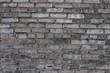Texture of an old wall made of gray bricks. Material, surface.