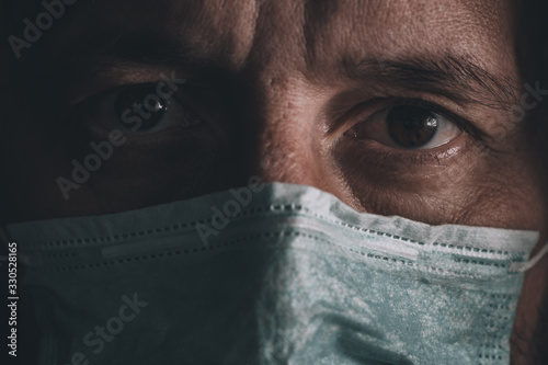 Afraid man with disposable respiratory mask Wallpaper Mural